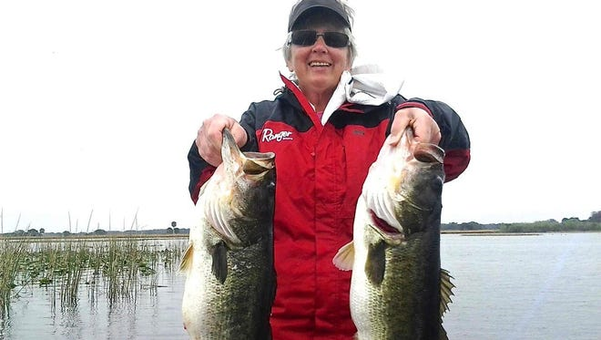 More trophy bass catches like this one by Sandy Geertman on Lake Kissimmee is one of the goals under Florida's new bass management plan starting on July 1.