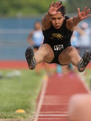 Tiffany Bautista, of Paramus Catholic, comes in for a landing during the long jump. Saturday, June 9, 2018