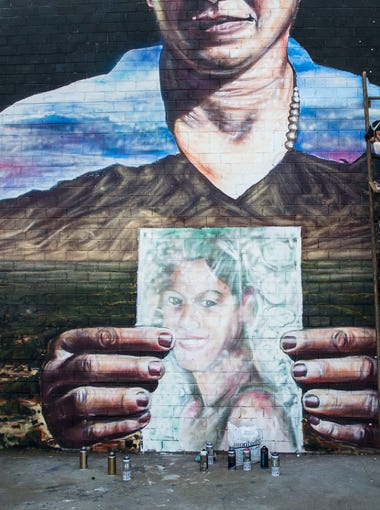 New York artist Mata Ruda is working with a number of Phoenix artists on a large mural in the Grand Avenue district in Phoenix on July 22, 2015. The project echoes the issues of immigration and migrant rights, and the mural represents those crossing the border who died in the Arizona desert.