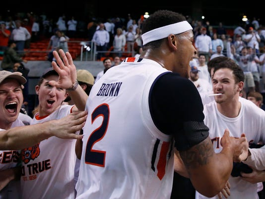 Fans cheer with Auburn guard Bryce Brown during the second half of the team's NCAA college basketball game against Kentucky on Wednesday, Feb. 14, 2018, in Auburn, Ala. Auburn won 76-66. (AP Photo/Brynn Anderson)