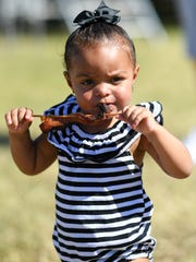 Khloe' Kuypern, 2, nibbled away at her bacon on a stick