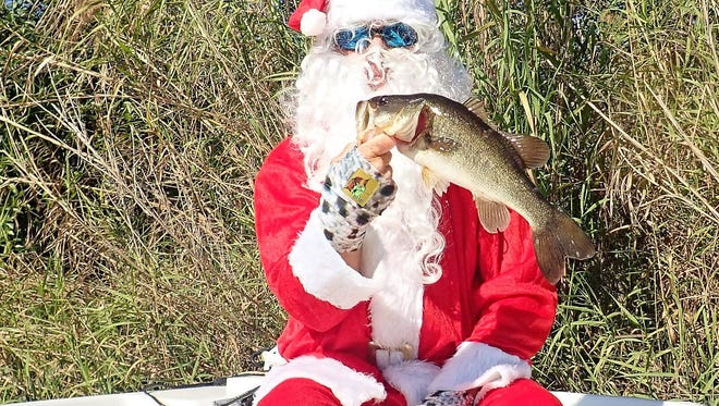 Santa Claus took a short break from his last minute preparations to reel in a couple of bass while fishing with Capt. Danny Barrow of Silver Lining Fishing Charters in Hypoluxo.