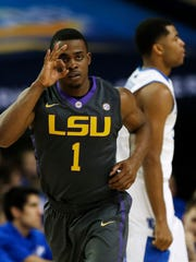 LSU guard Anthony Hickey celebrates his three-point shot against Kentucky during the SEC tournament on March 14, 2014, in Atlanta.