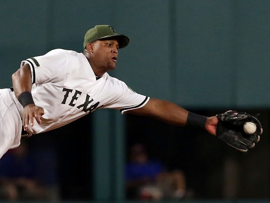 Texas Rangers third baseman Adrian Beltre (29) makes a diving catch on a ball hit by Tampa Bay Rays Derek Norris in the seventh inning of a baseball game in Arlington, Texas, Monday, May 29, 2017.(AP Photo/Richard W. Rodriguez)