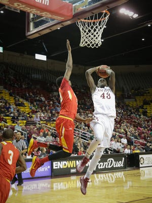 New Mexico State's Pascal Siakam (43) goes go for a shot while being defended by Arizona Christian's Sharif Watson Wednesday night a the Pan American Center.