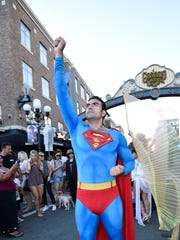 Sergio Valente, dressed as Superman, outside of the