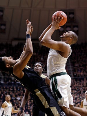 Purdue forward Vince Edwards (12) draws the charge from Michigan State forward Nick Ward (44) in the first half of an NCAA college basketball game in West Lafayette, Ind., Saturday, Feb. 18, 2017. (AP Photo/Michael Conroy)