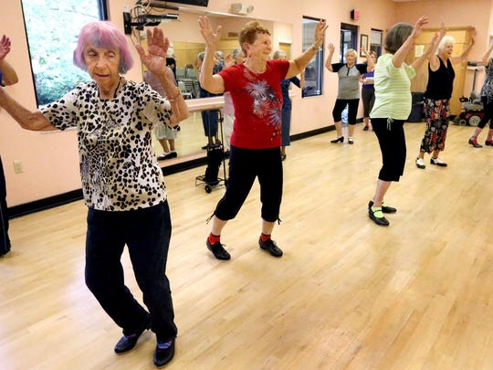 Students in Michelle Palmer's tap class (L to R) Janet Hawley-Whitmore, Thelma Gonder, Jo Ann Bardet, Donna Tuma, and Adella Harter on the back row Elynn Pytlewski, follow Palmer's lead in class, on Monday, Sept. 21, 2015, at the St. Claire Street Senior Center.