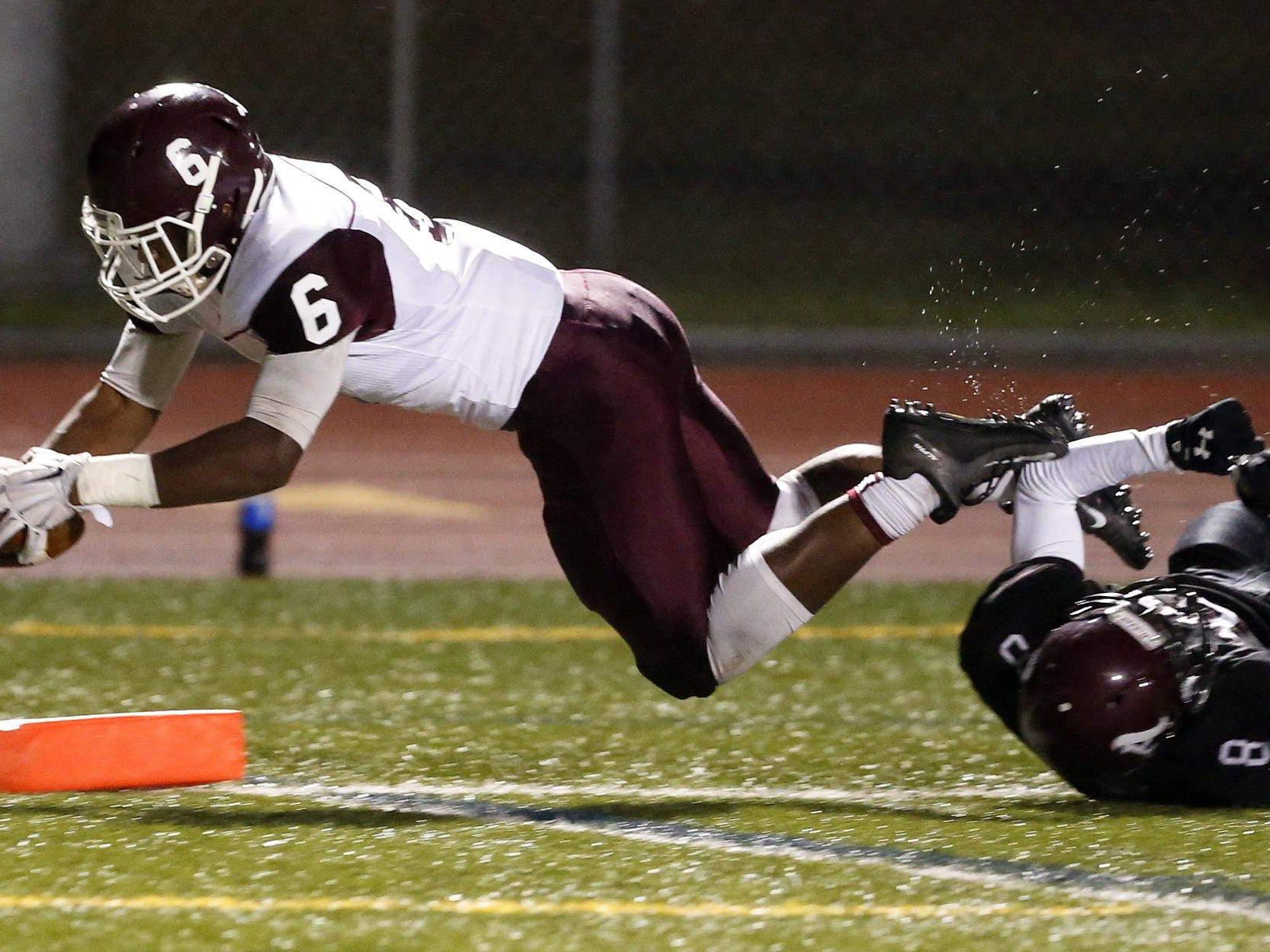 Concord's Grahm Roberts falls into the end zone in the Raiders' 32-21 win at Appoquinimink on Friday.