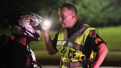 A Lafayette Police officer conducts a sobriety check.