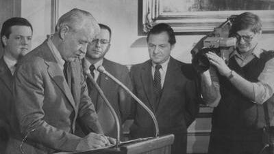 In this 1983 photo, Gov. Robert Or signs an open records bill into law.