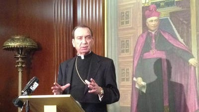 Archbishop Dennis Schnurr speaks at the offices of the Archdiocese of Cincinnati, which publishes The Catholic Telegraph newspaper. The newspaper will become a magazine in June.