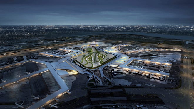 This undated artist rendering provided by the Office of the Governor of New York shows what the renovated JFK Airport would look like from the air. On Jan. 4, 2017, New York Gov. Andrew Cuomo unveiled a $10 billion plan to transform New York's aging airport into a world-class hub with easier access.