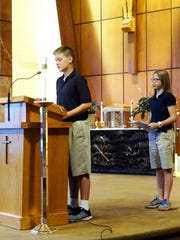 Michael Ross and Lisa Sullinger participate in St. Paul School's Sept. 9 for a Day of Prayer and Penance for Peace.