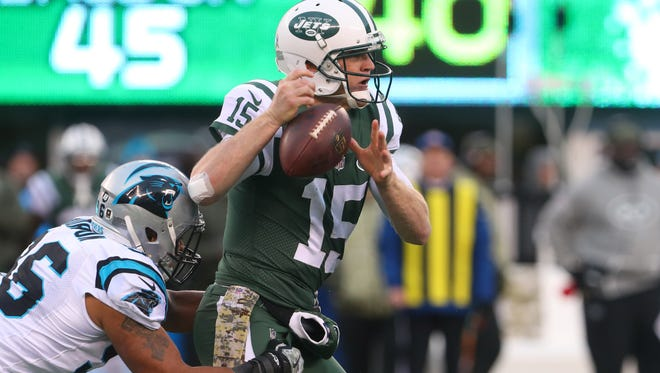 Carolina Panthers defensive end Wes Horton forces a fumble by New York Jets quarterback Josh McCown during the second half at MetLife Stadium.