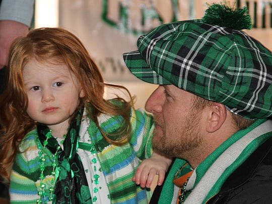 St. Patrick's Day will be celebrated Saturday with live Irish music, dancers, a parade, food and beer. A contest for the reddest hair was won by Mckenzey Puyleart, pictured in this file photo.