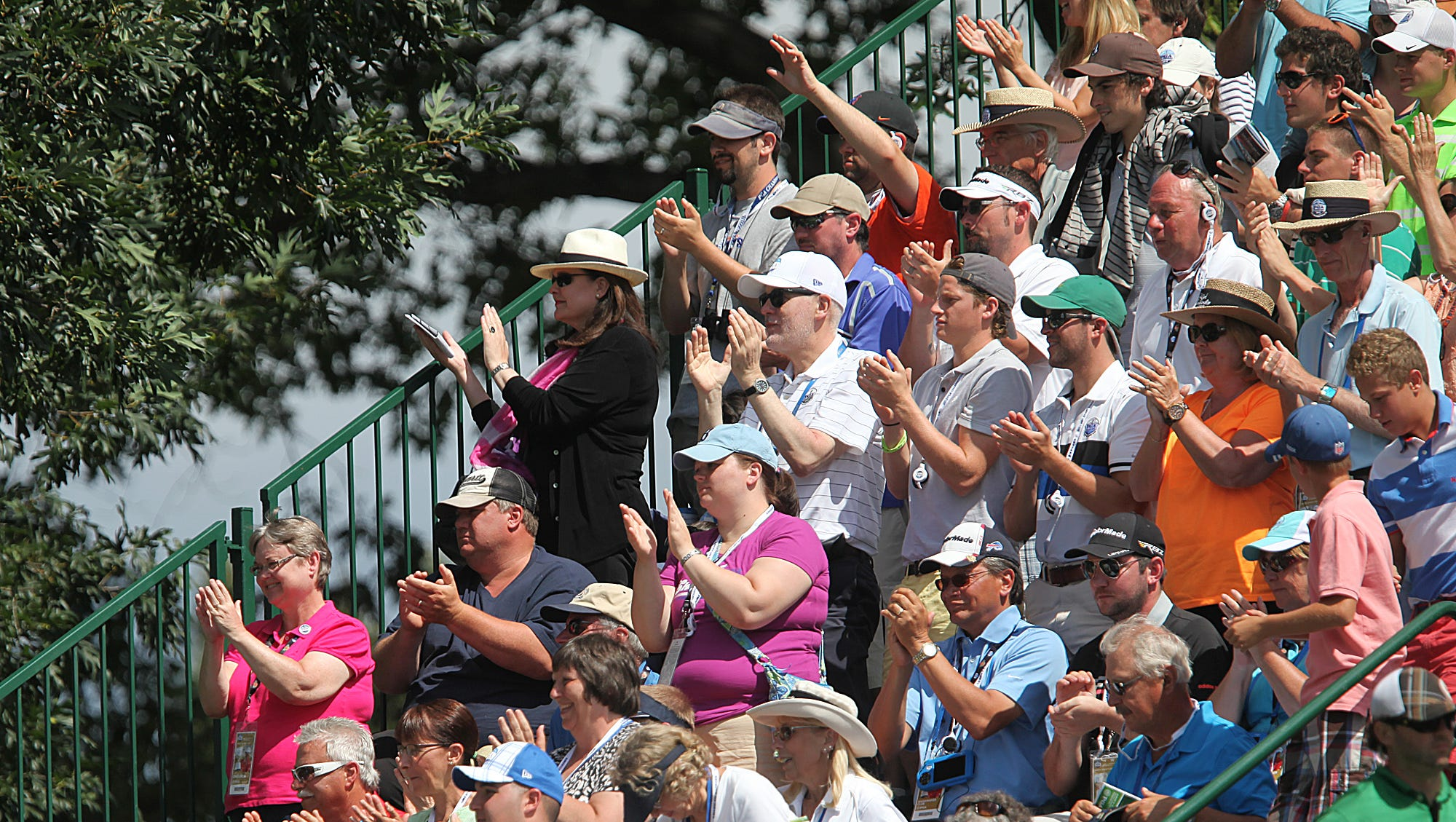 Fans applaud Phil Mickelson as he leaves 18 after finishing his last round of golf at the 95th PGA Championship at Oak Hill. P