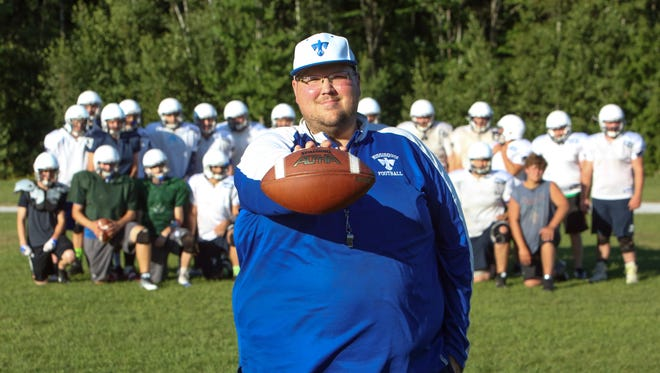 Missisquoi coach Eric Bushey poses with his team during a recent practice in Swanton. Bushey and the Thunderbirds, despite little support from the school, are set for their varsity debut this Saturday at BFA-Fairfax.