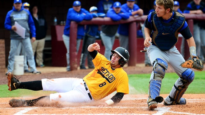 Peabody's Matthew Pickard slides safely into home base during game 12 of the 2015 Class A State Baseball Torunament, Thursday against Summertown.