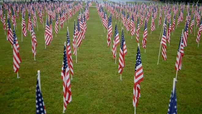 The Jackson Exchange Club's Flags of Freedom are on display on the lawn of First Cumberland Presbyterian Church.