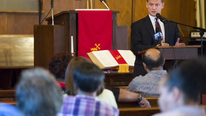 Attorney General Matt Denn speaks to community members at the Central Baptist Church in Wilmington on Monday evening.