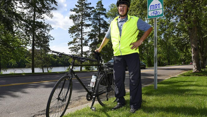 Kurt Franke commutes to work June 25 on a portion of the Mississippi River Trail that runs along Riverside Drive Southeast through St. Cloud. Franke helped test parts of the trail, which runs from Itasca State Park to the Gulf of Mexico.