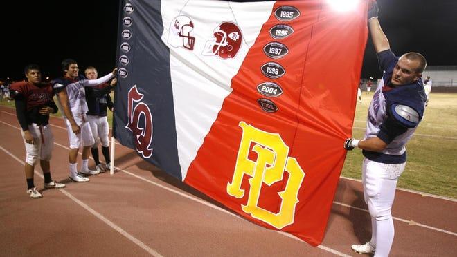 11-12-08 cq Chris Ruiz, Andrew Jones, Trent Laddusaw and Ty James La Quinta High School football players hold the La Quinta High School and Palm Desert High School Victory flag. The two teams play November 14. Wade Byars
