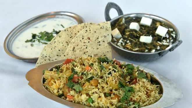 Vegetarian biryani (mixed rice with vegetables), front, and saag paneer (creamy spinach with fresh cheese), right, are being served at the Nov. 7 Diwali dinner being presented by the India Association of Northern Nevada. Vegetarian meals are eaten to mark Diwali, the most important Hindu festival in India.ANDY BARRON/RGJ