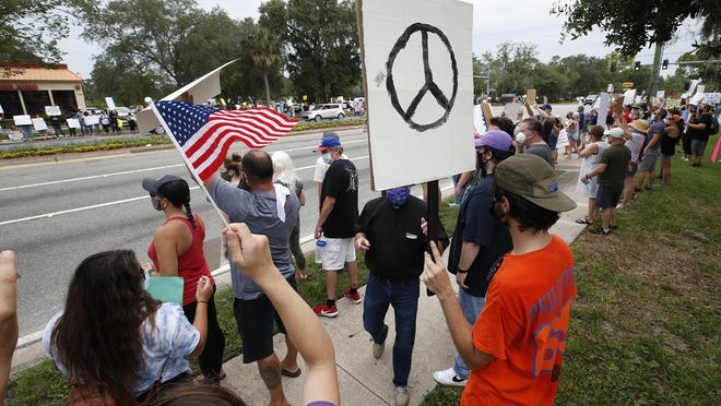 Protesters stage a peaceful march in New Smyrna Beach, Sunday, June 7, 2020.