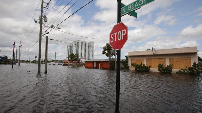 Flooding along North Beach Street in Holly Hill in the aftermath of Hurricane Irma on Sept. 11, 2017. A new national flood modeling tool released Monday, June 29, 2020, by the First Street Foundation lists Holly Hill and two other Volusia County cities among the top five in Florida that will see the biggest percentage growth in flood-risk properties by 2050. The other Volusia cities are Ormond-by-the-Sea and Edgewater.