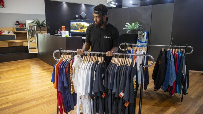 Kel Pearson is owner of Magik, a garment and footwear store at the Domain in North Austin.  After showing moderate growth in June, Texas service sector activity contracted in July and retail sales plunged amid the ongoing coronavirus pandemic.