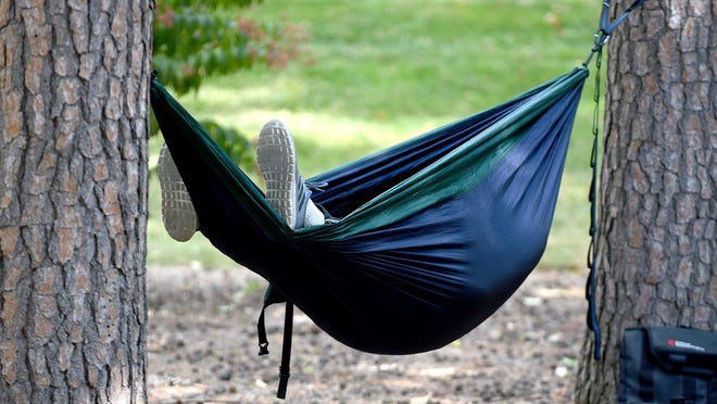 Grant Kilber of Overland Park, Kansas, enjoys a nap Friday afternoon in his hammock in Peace Park. Kilber drove to the University of Missouri College of Veterinary Medicine to have a root canal for his dog Nia. He said the cost of the surgery at the vet school was about half the price of canine surgery in the surrounding Kansas City area.