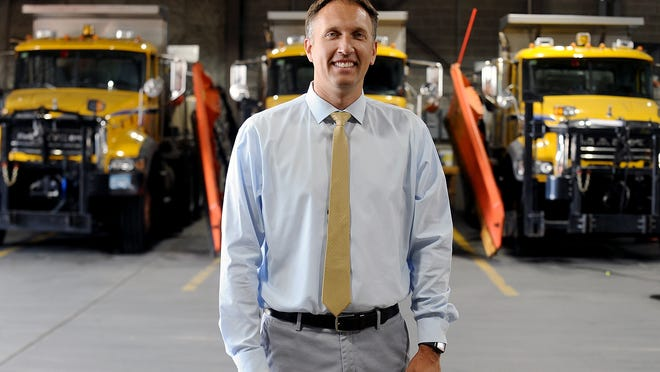 Blake Lukis, shown in the Framingham Public Works Department garage, was named permanent director of the DPW in mid-July.