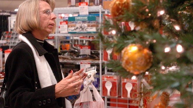 A shopper looks at Christmas ornaments in the J.C. Penney store at Augusta Mall in this file image.