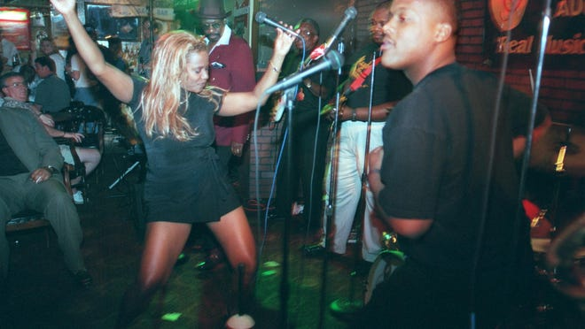"""Singer TuTu D'Vyne (left) and PlayBack """"The Band"""" shake up the crowd at the Surrey Tavern in April 1999."""