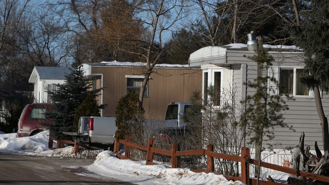 Four mobile homes can be seen in Edgewood Country Estates in Mosinee -- the neighborhood where the Feb. 20 home invasion took place -- on Friday, February 27, 2015.