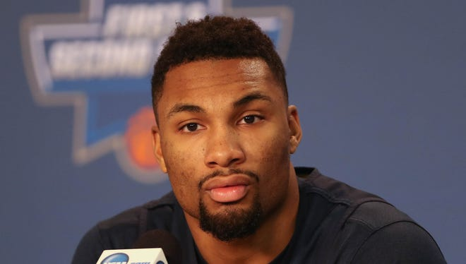 Michigan Wolverines guard Zak Irvin talks with reporters Saturday, March 18, 2017 at Bankers Life Fieldhouse in Indianapolis.