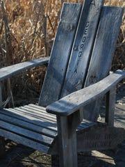 Adirondack chairs on the boardwalk point Appalachian Trail hikers toward Maine and Georgia.