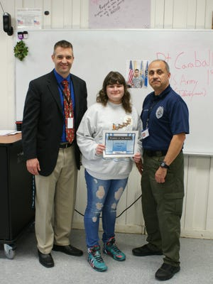 (From left) Greg McGraw, principal of Cumberland County Technical Education Center; Ashley Clark, the center's Student of the Month for December; and law enforcement instructor Andres Lopez.