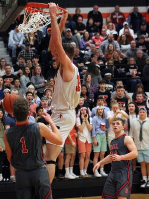 Kewanee's Carson Sauer delivers a slam dunk for his 1,000th point during Tuesday's Three Rivers Conference game against Hall at Brockman Gymnasium.