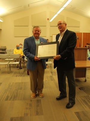 John Gronberg, left, receives Park Township's Spotlight Award from Park Township Supervisor Jerry Hunsburger, right, on June 11, 2020.