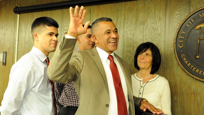 Michael Santiago is sworn in as mayor of Millville with his wife Lisa and sons Dominick, 22 (left), and Emilio, 19, at City Hall on Thursday, January 2, 2014.  Staff photo/Charles J. Olson