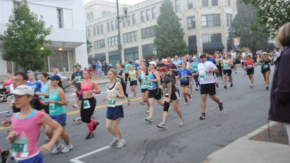 Runners take part in the Asheville Citizen-Times Half Marathon a few years ago. A new half marathon roughly following the old course will be Sept. 5.
