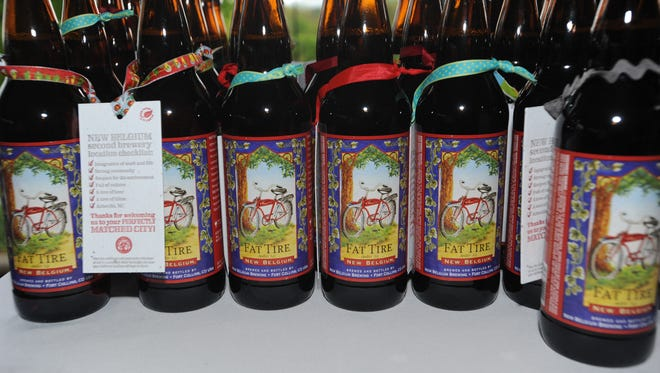 Bottles of New Belgium Brewing's Fat Tire Amber Ale at the company's 2012 announcement that it would build a brewery in Asheville.