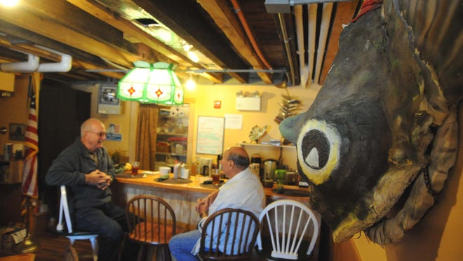 Customers chat at the Oyster Cracker Cafe in 2012 in Port Norris.