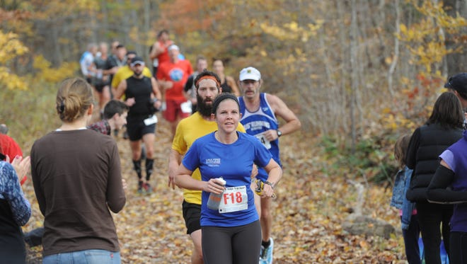 Runners take part in a past Shut-In Ridge Trail Run along the Blue Ridge Parkway, which ends at the Mount Pisgah parking area.