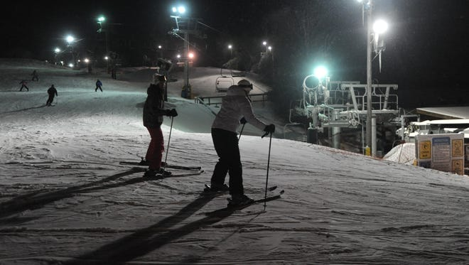 People enjoy a night ski at Cataloochee in Maggie Valley in 2014.