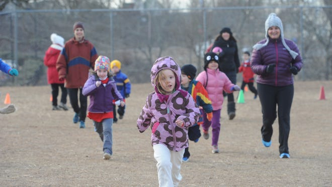 Children take part in the Isaac Dickson Hot Chocolate  Marshmallow  Dash last year. The event on Saturday also includes a 10K race and a 1K Kids Hill Climb.