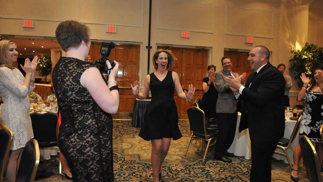 Stephen Decatur English teacher Kristina Belcher reacts with joy after winning the 2016 Worcester County Teacher of the Year award.