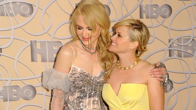 Nicole Kidman, left, and Reese Witherspoon arrive at the HBO Golden Globes afterparty at the Beverly Hilton Hotel on Sunday, Jan. 8, 2017, in Beverly Hills, Calif. (Photo by Richard Shotwell/Invision/AP)